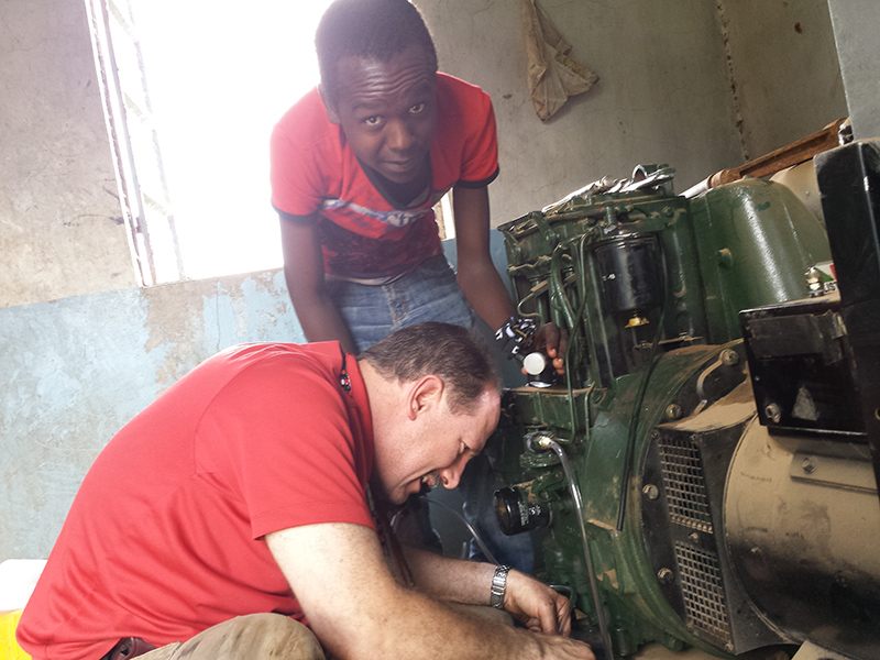 Cliff & Maasai youth fixing the Ewauso well pump generator